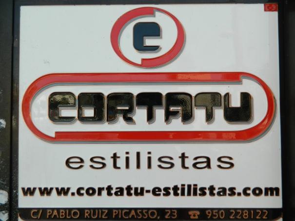 Publicidad de una peluquería almeriense.